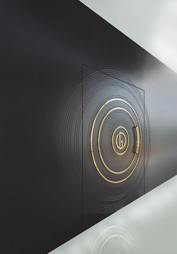 Pivot door covered with lacquered & decorative bronze circles