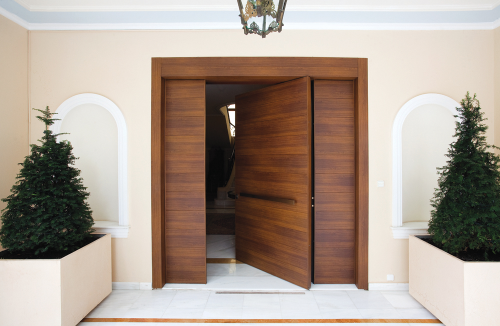 Pivot Door covered with aluminum insets and steady side parts made of the same material
