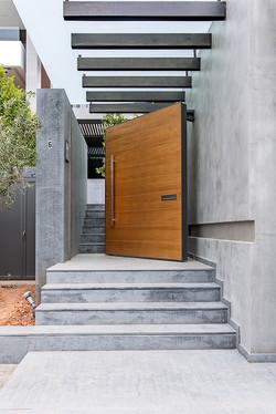 Pivot Door covered with oak veneer,