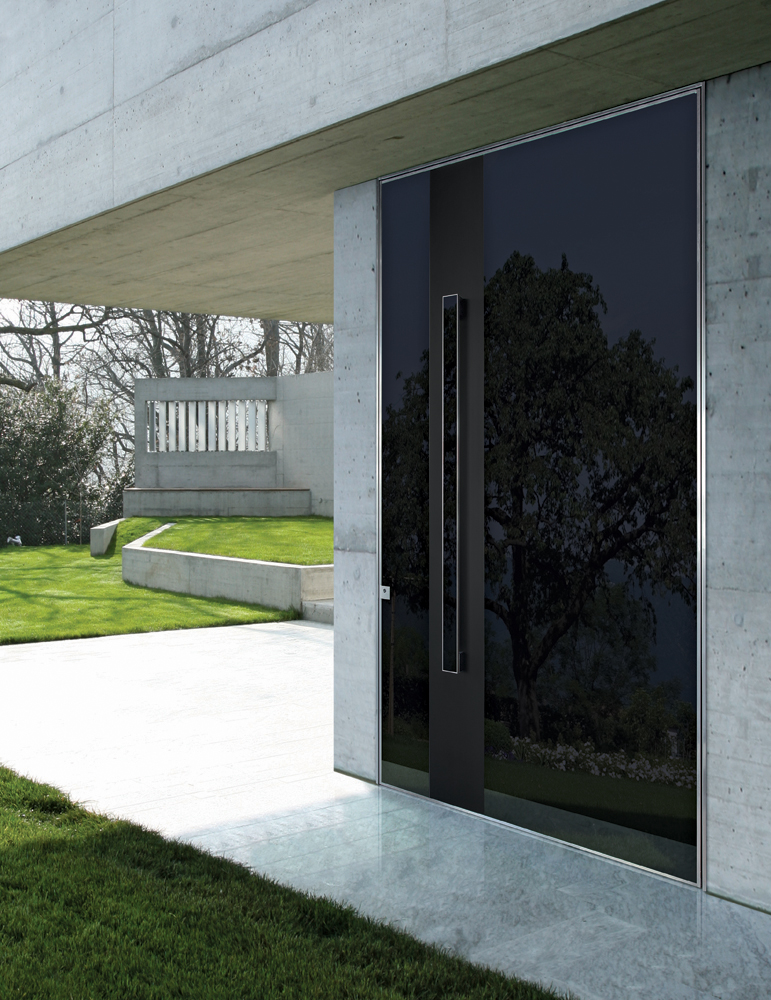 Pivot Security Door covered with glass and anodized aluminum. Handle with surface made of the same m