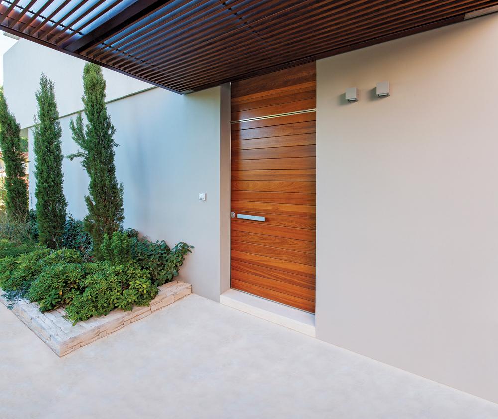 Pivot Door covered with iroko wood.