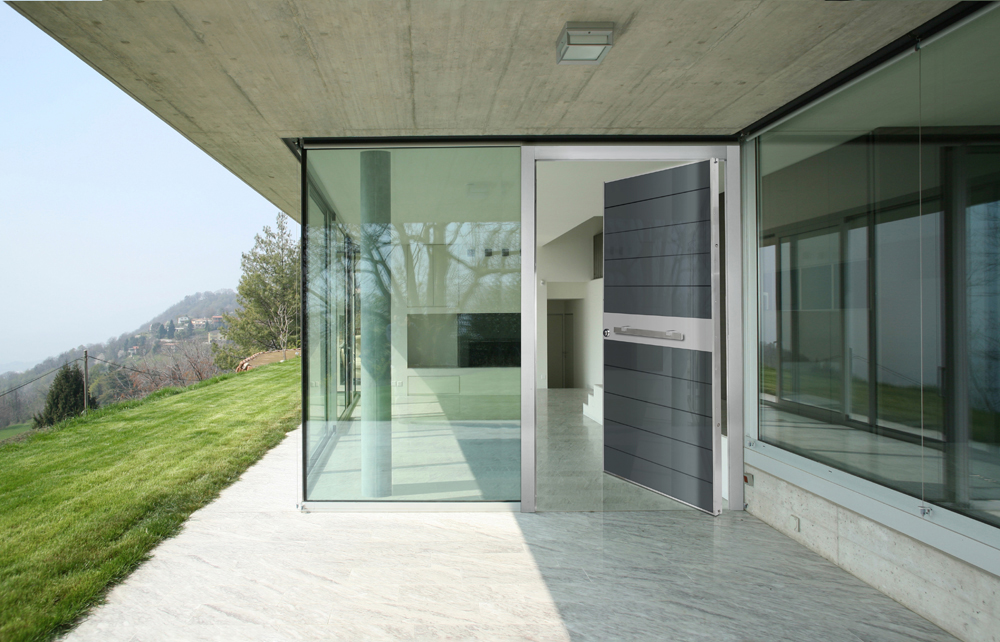 Pivot Door covered with glass insets and stainless steel