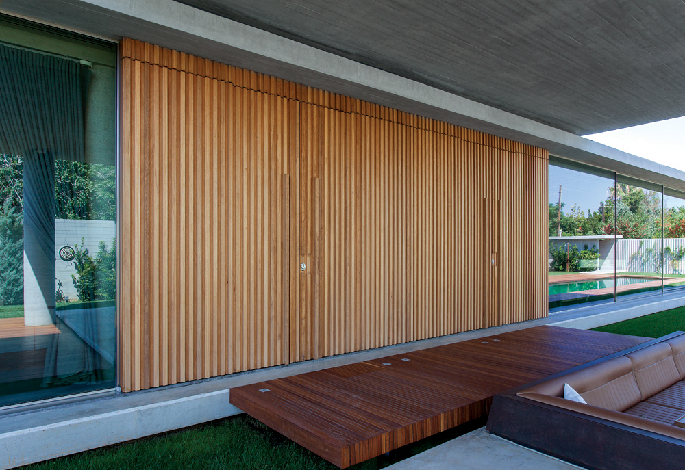 Special construction with four pivot doors, covered with meranti wood