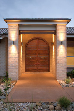 Oval double door covered with meranti wood