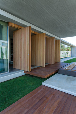 Special construction with four pivot doors, covered with meranti wood..