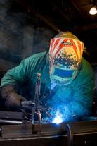 Worker Welding Steel