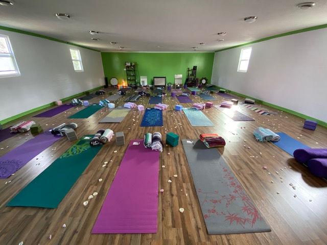Small Group Yoga Lesson In Studio