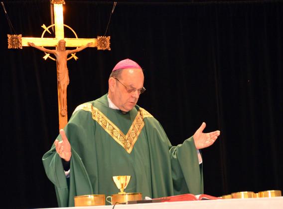 Priest Prays Over Bread and Wine.jpg