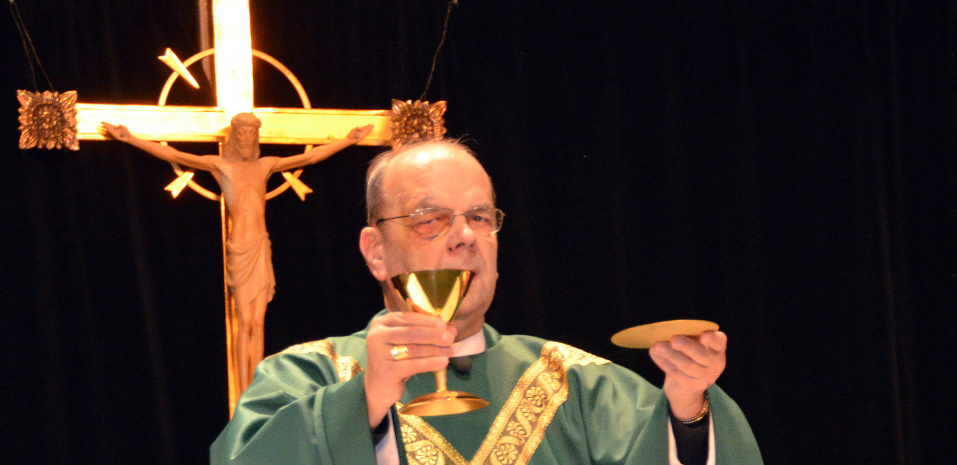 Priest Offers Up Bread and Wine.jpg
