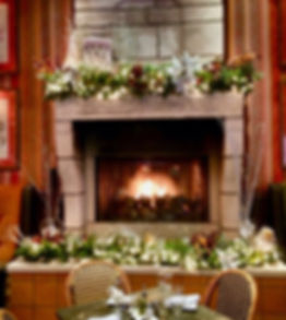 Holiday decor around a fireplace inside the Trezo Mare restaurant lounge