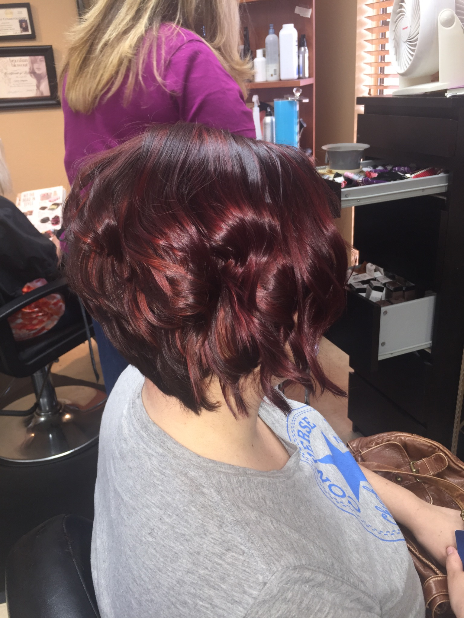 Vibrant Red and cut into angled bob
