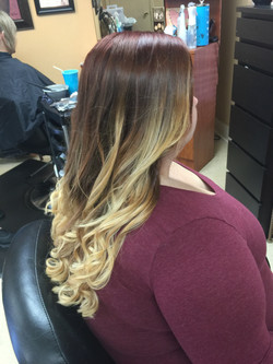 Red to blonde ombre in curls