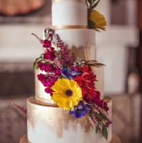 Gold painted bright flowers wedding cake