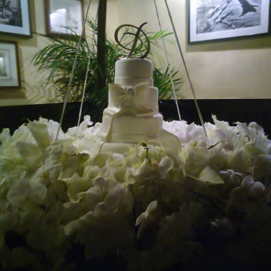 hanging White Bow Wedding Cake.jpg