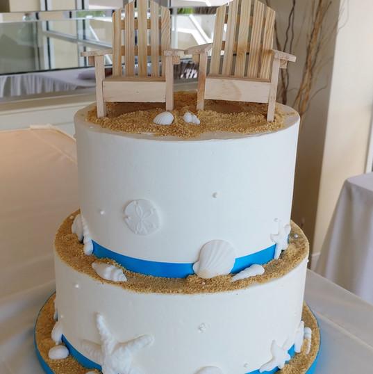 Beach Chair and Sea shells wedding cake.
