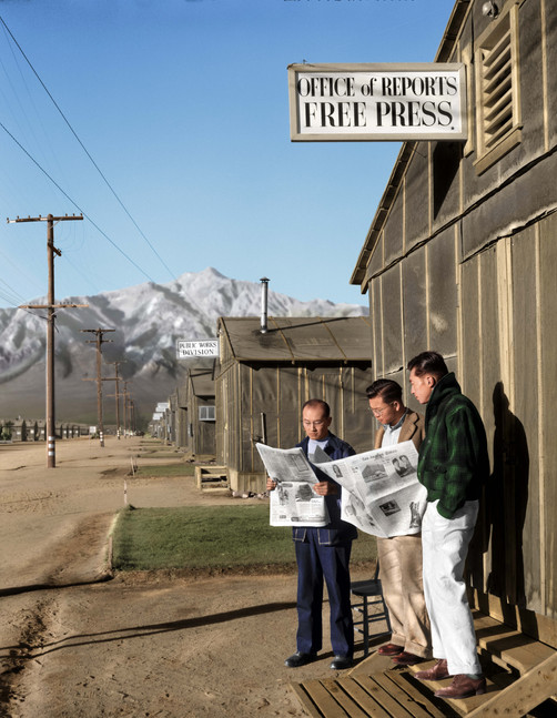 """Roy Takeno (Editor) and group reading Manzanar paper [i.e. Los Angeles Times] in front of office, Yuichi Hirata, Nabuo Samamura, Manzanar Relocation Center, California""."