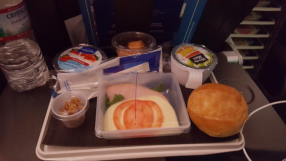 Ham, cheese, tomato, lettuce, warm roll, fruit, yogurt and granola, OJ