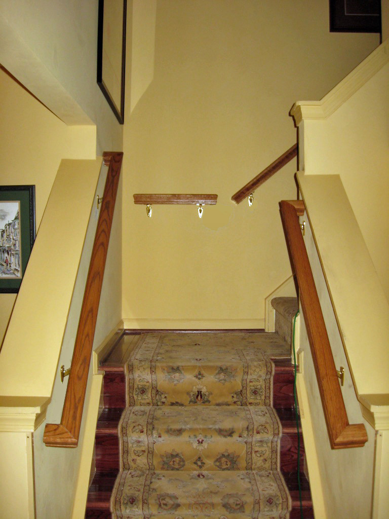 A second railing installed on the other side of the staircase can increase safety.