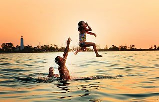 Family Playing In Water At Beach.jpg