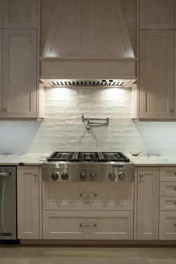 Custom kitchen, gas range and hood