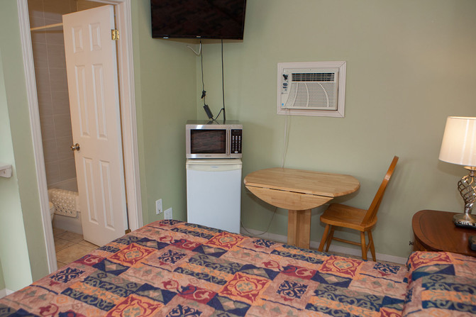 Small Fridge, Microwave and Table.