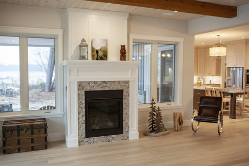 Custom fire place in open concept living space, view of Lake Huron