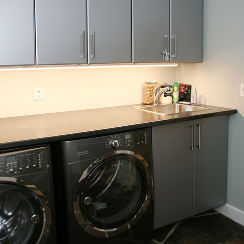 Cabinets above washer and dryer in custom home, Port Elgin ON