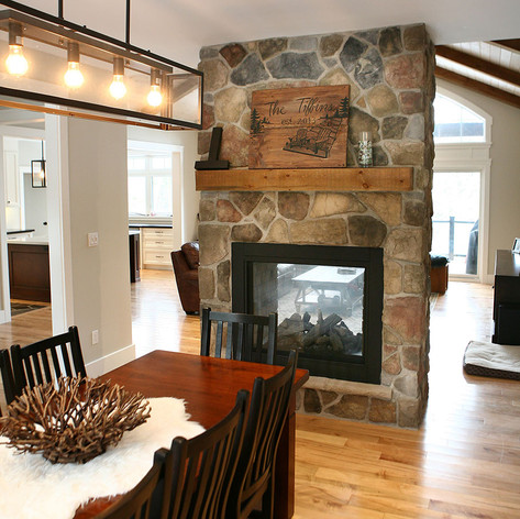 Double sided fireplace in custom home, Saugeen Shores ON