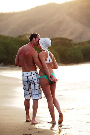 Stock Photo of Couple Walking On Beach in Costa Rica