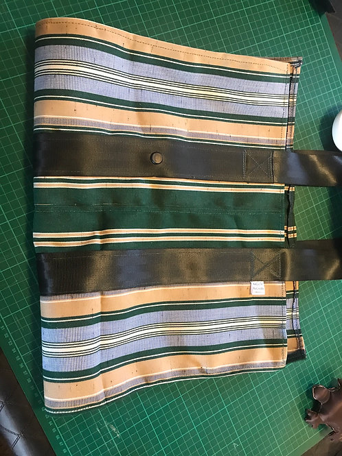 Green and gold firewood carrier