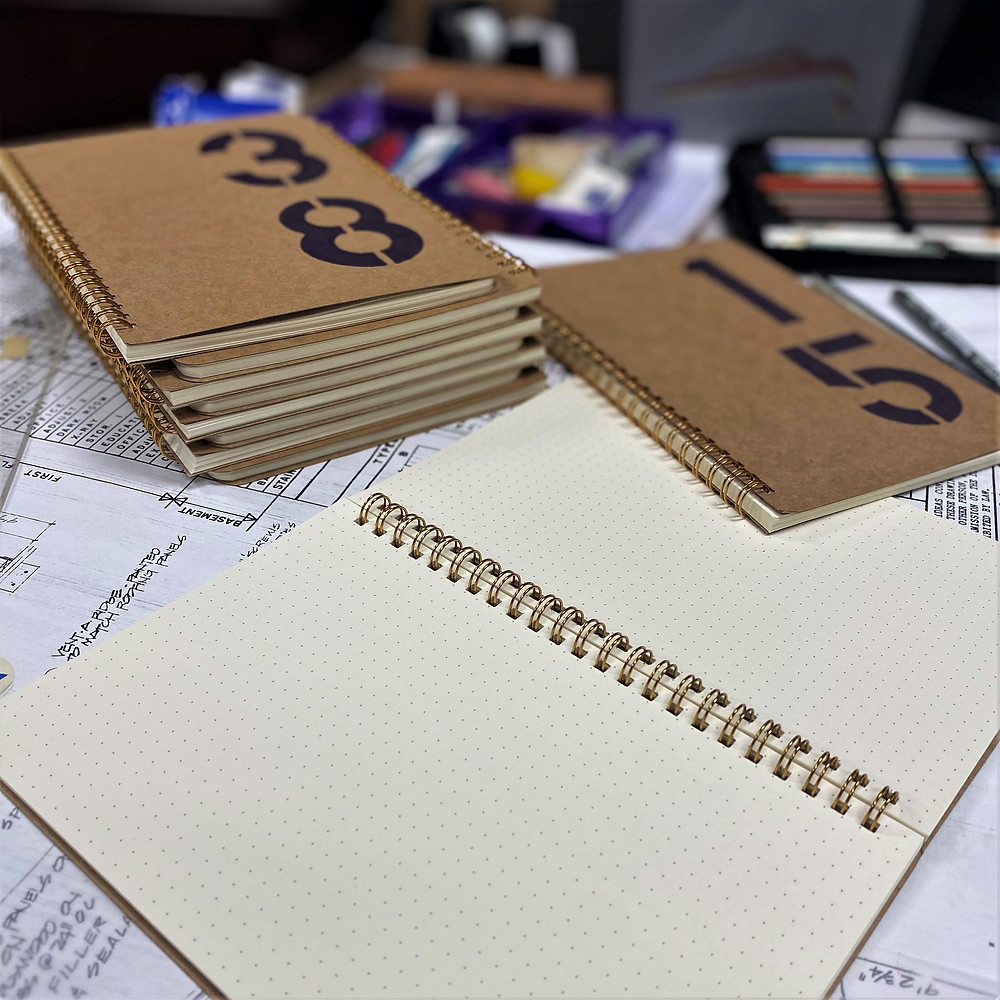 Sketchbooks with hand-stenciled numbers.