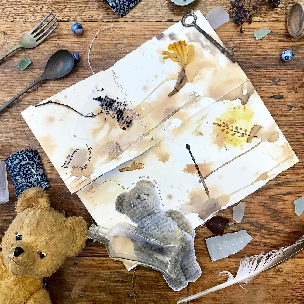 A collection of wabi sabi objects, including broken pottery and a worn out teddy bear.