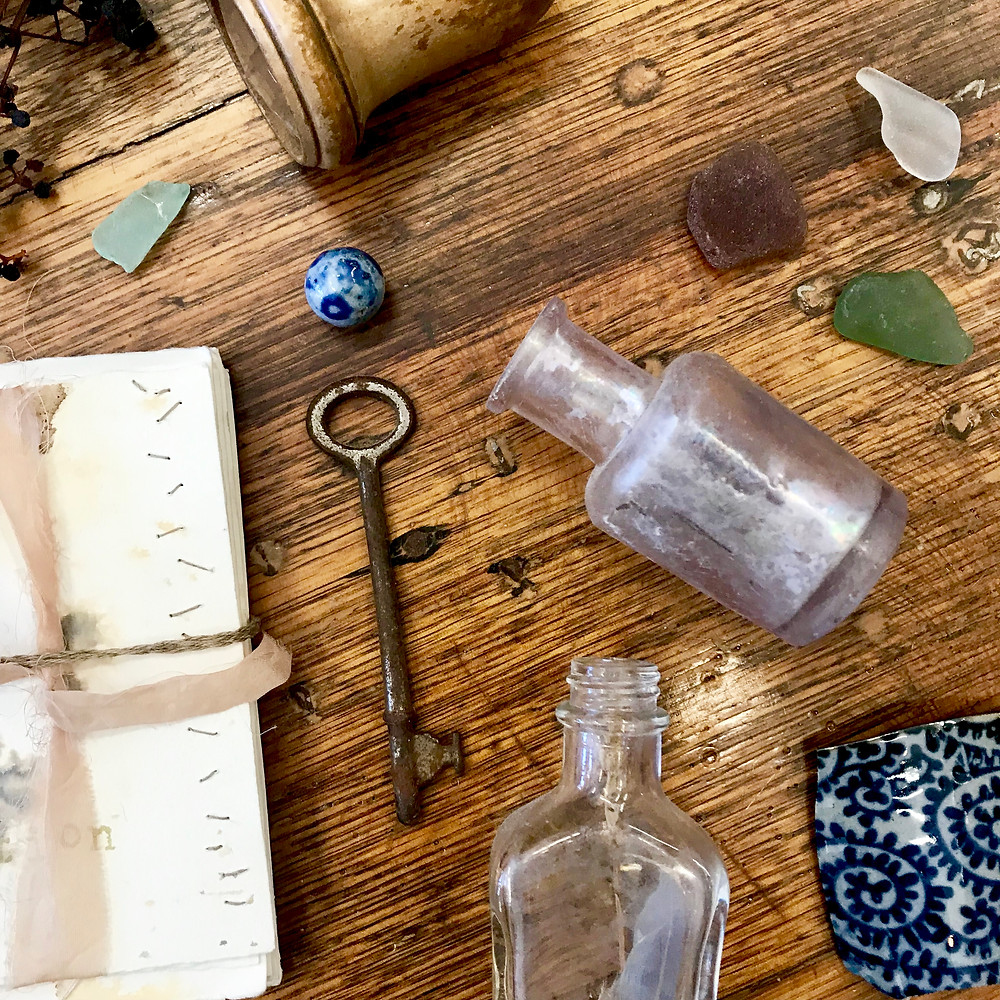 Some wabi sabi themed objects such as broken pottery and a rusted key