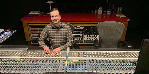 Cadu Byington mixing in the studio working by a SSL console