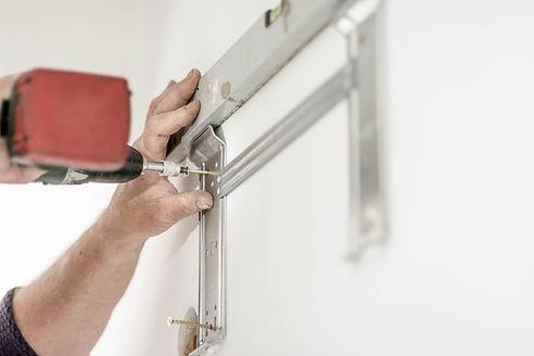 garage door company repair man working
