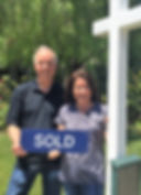 Dan and Debi Keen are stnding in front of their Hillside Park Novato home, just sold by Team McGinnis Novato Realtors