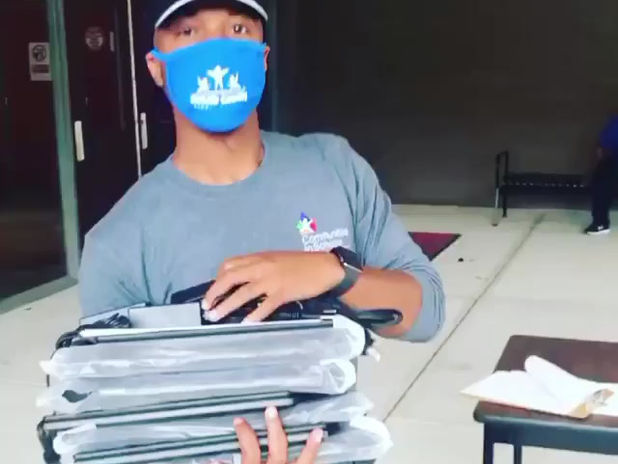 CIS Site Coordinator Delivers Chromebooks
