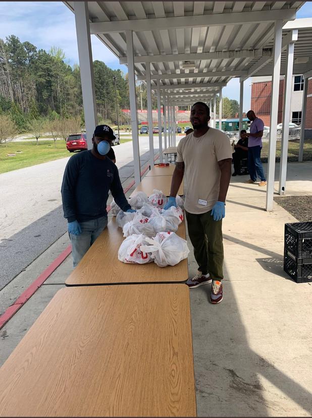 CIS of Atlanta Team Volunteers with Food Distribution