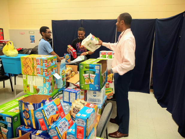CIS Site Coordinator Packs Bags for Students and Families