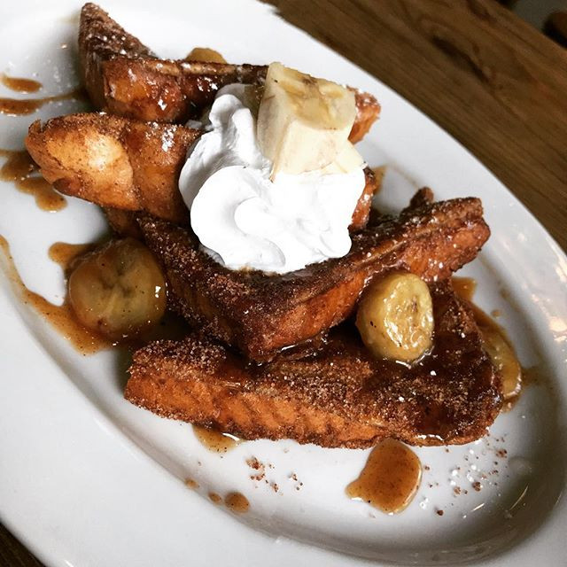 Bananas Foster French toast garnished wi