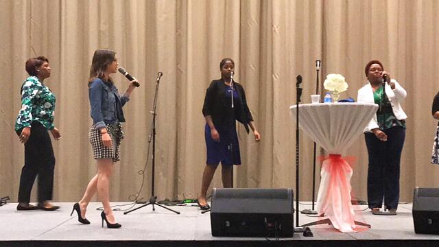Min Ebeth Fielder leading prayer