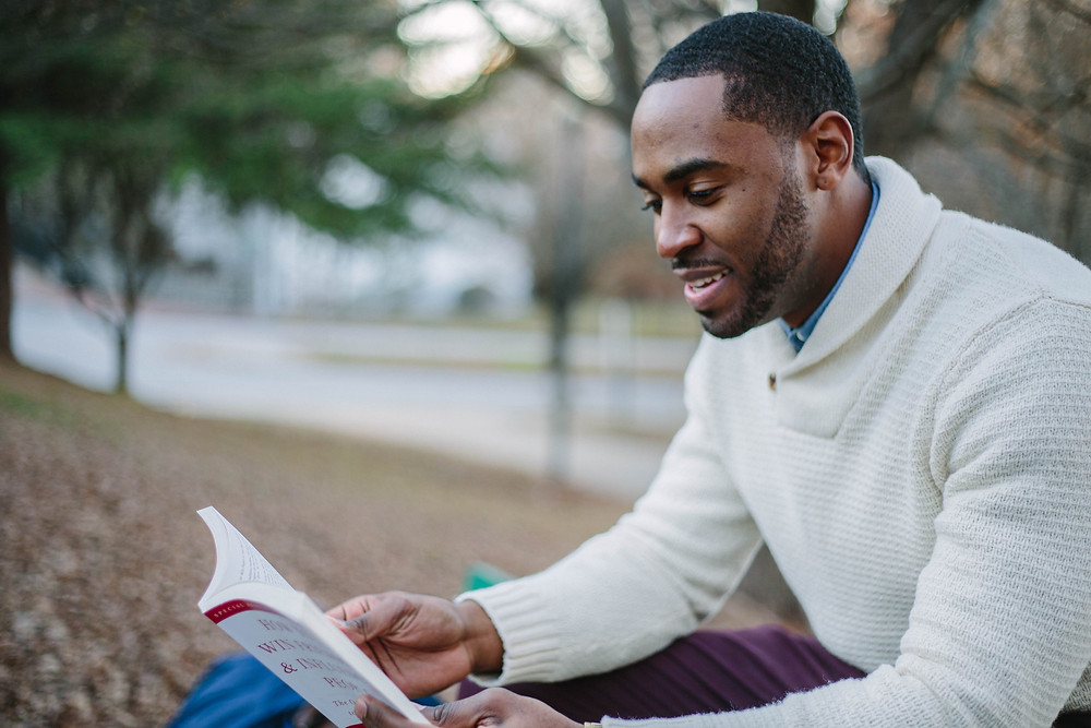 Black man reviewing a book