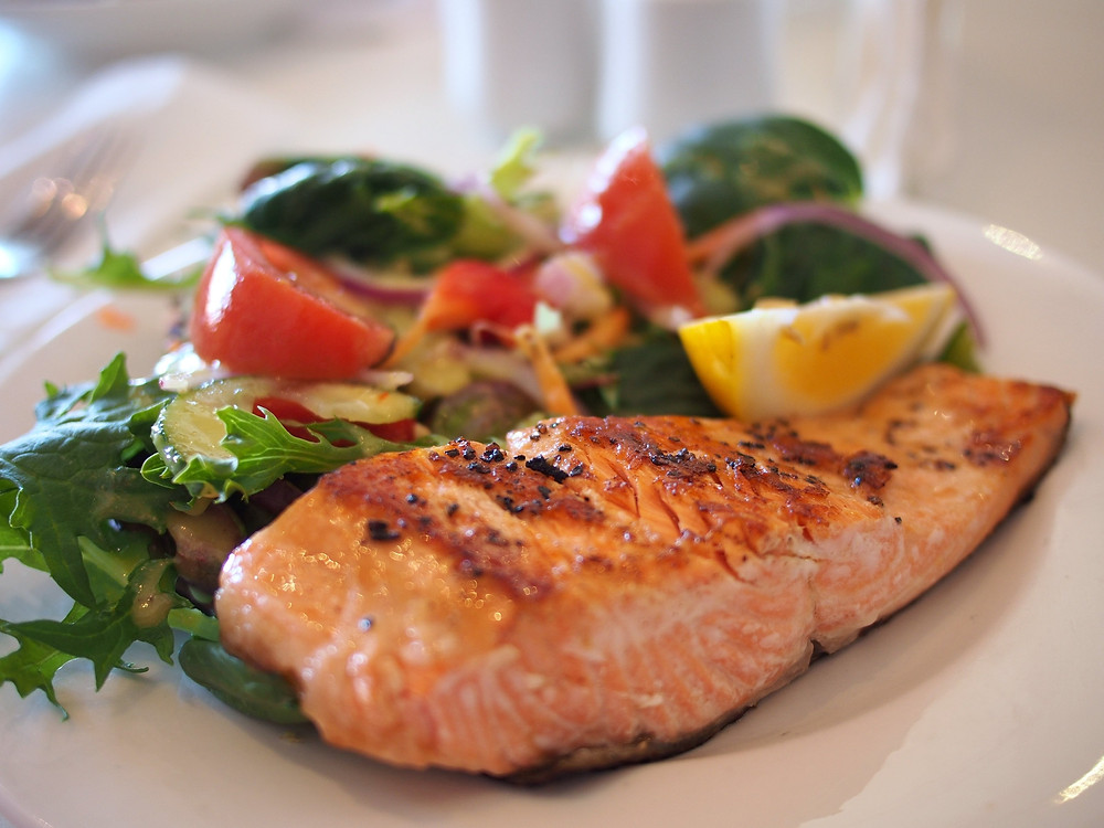 Plate of salad and salmon for creative writers