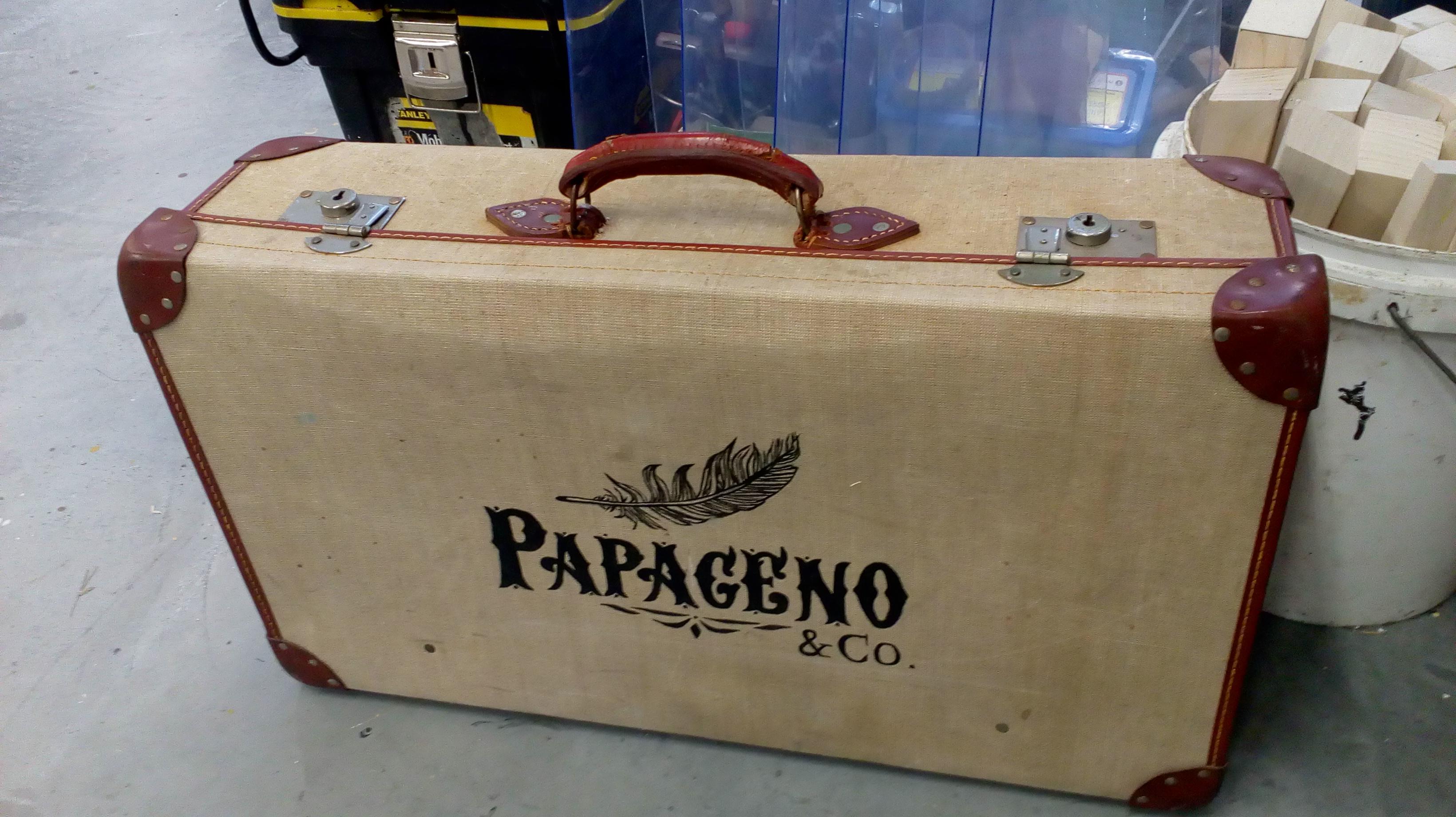 Painted suitcase logo