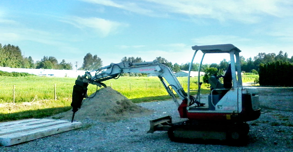 Mini Excavator - Jackhammering