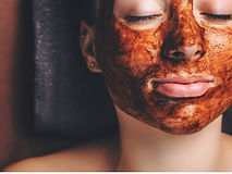 chocolate-mask-applied-on-the-womans-fac