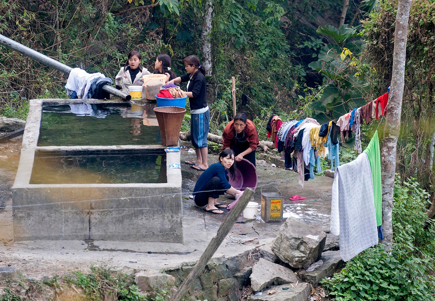 The laundry is dealt with by the younger members of the family. A pipe of clean water runs down the moutainside in to the huge washing baths.