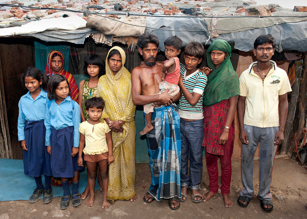 Poornami, 8, and her family, New Delhi Landfill Pickers