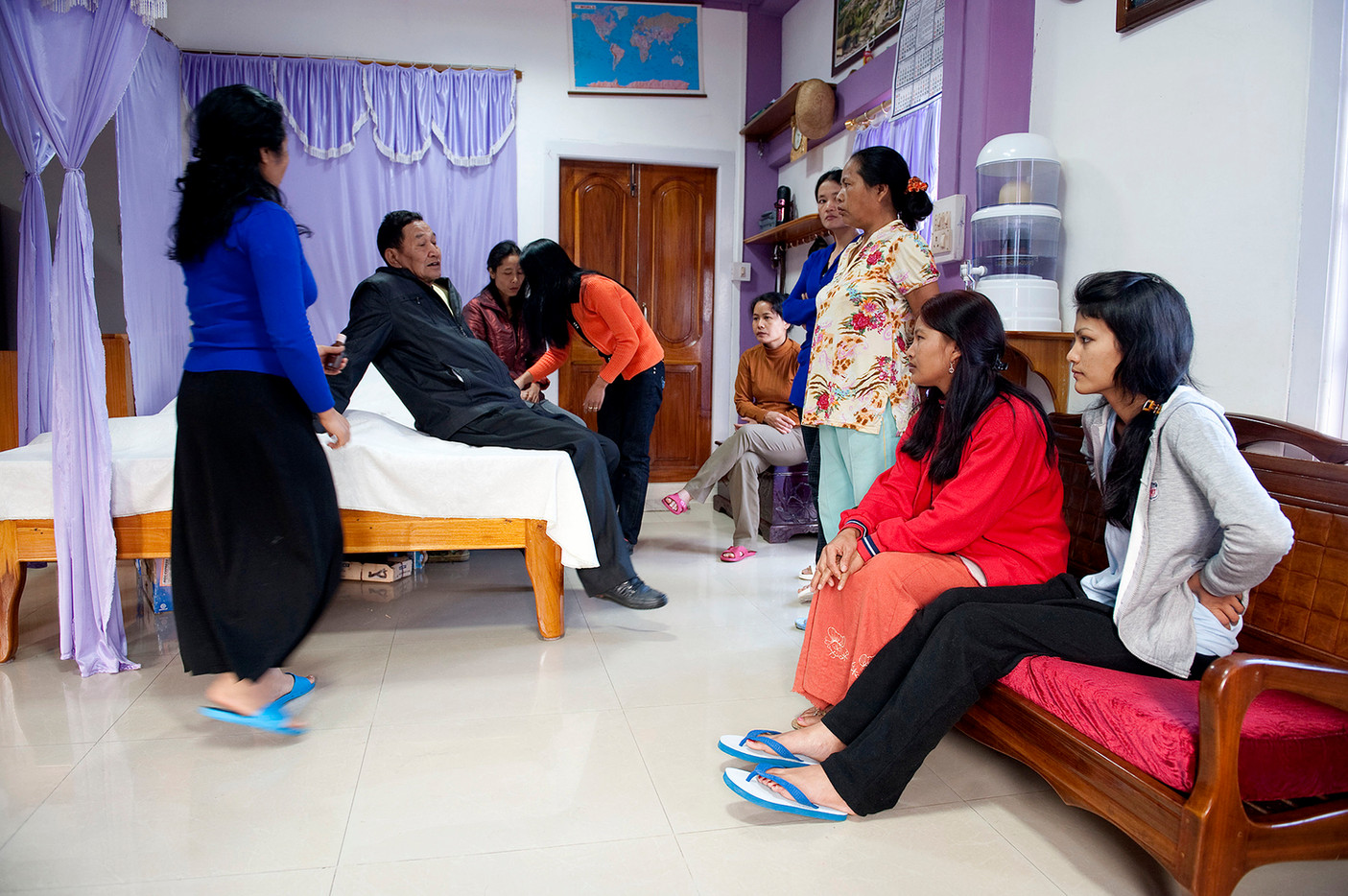 Ziona with some of his wives in his bedroom.