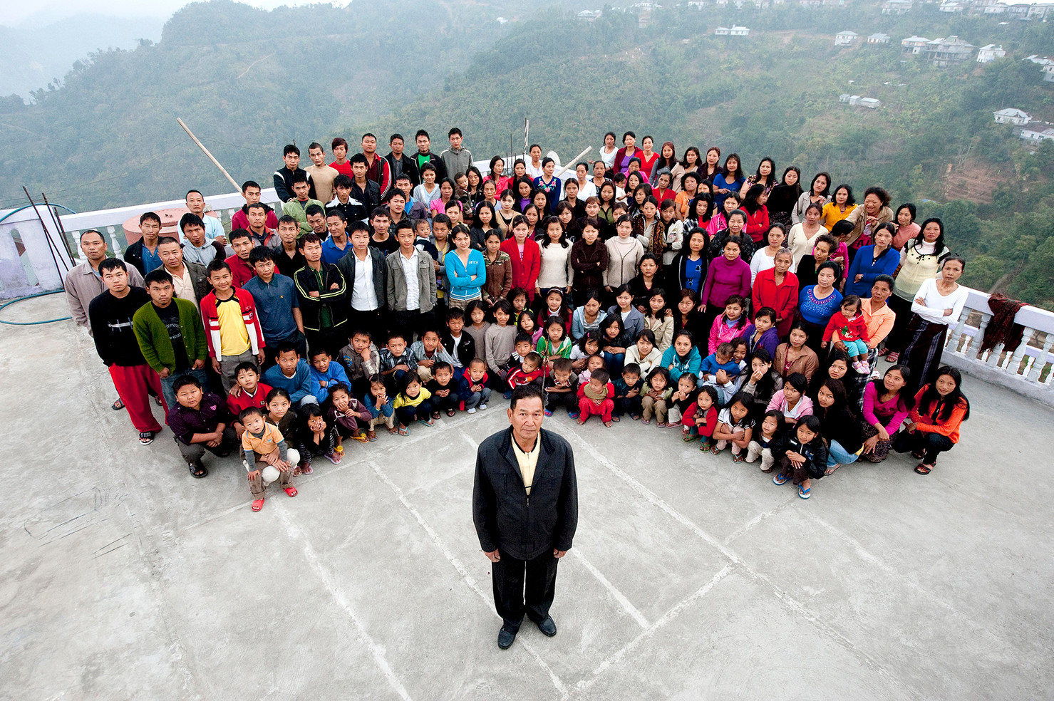 The Worlds Largest Family. Baktawng, Mizoram, India. Ziona Chana lives with his 39 wives, 94 children, 14 daughters-in-law and 33 grand children in the mountainous region in north east India. The family are self sufficient growing all their fruit and vegetables and rearing their own chickens and pigs.